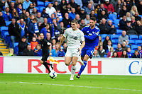 Sam Vokes of Burnley vies for possession with Sean Morrison of Cardiff City during the Premier League match between Cardiff City and Burnley at Cardiff City Stadium in Cardiff, Wales, UK. Sunday 30 September 2018