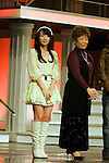 """Tokyo, Dec. 30, 2009 - Nana MIZUKI (L) is photographed during the second day of rehearsals for 'Kohaku Uta Gassen,' or also more commonly known as 'Kohaku.' Produced by the Japanese public broadcaster, NHK, this annual music show airs on New Year's Eve and ends shortly before midnight, where everyone on air pauses to say """"Happy New Year."""" The 'Red and White Song Battle' separates the most popular music artists during each given year into teams of red and white: the red team consists of all female artists and the white team is all male artists. For an artist to perform on Kohaku, it is a great honor as only the most successful enka singers and J-Pop artist are strictly invited to perform by invitation only. Today, for a J-Pop artist or enka singer to perform on Kohaku, is most notably recognized to be a big highlight in a singer's career due to the show's large reach of audience during New Year's Eve."""