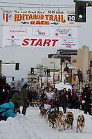 2010 Iditarod Ceremonial Start in Anchorage Alaska musher # 1 Merissa Osmar with Iditarider Orin Seybert