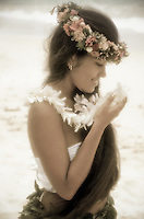 Young Hawaiian woman with ginger and haku leis