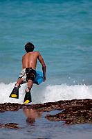 bodyboarders during large surf at Magic sands beach, Kailua Kona The Big Island of Hawaii