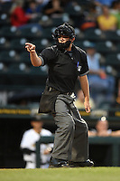 Home plate umpire Joe George makes a call during a game between the Jupiter Hammerheads and Bradenton Marauders on April 17, 2014 at McKechnie Field in Bradenton, Florida.  Bradenton defeated Jupiter 2-1.  (Mike Janes/Four Seam Images)