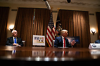 United States President Donald J. Trump speaks during a meeting with members of the National Association of Police Organizations Leadership in the Cabinet Room of the White House in Washington, DC, on July 31st, 2020.  Looking on at left is United States Vice President Mike Pence.<br /> Credit: Anna Moneymaker / Pool via CNP /MediaPunch