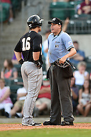 San Antonio Missions first baseman Jason Hagerty (16) argues a call with umpire Matthew Czajak during a game against the Arkansas Travelers on May 25, 2014 at Dickey-Stephens Park in Little Rock, Arkansas.  Arkansas defeated San Antonio 3-1.  (Mike Janes/Four Seam Images)