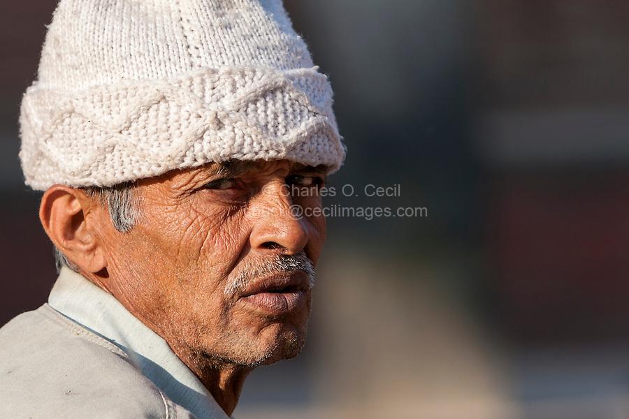 Nepal, Patan.  Elderly Nepalese Man Wearing a Traditional White Knit Hat.