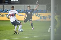 SAN JOSE, CA - OCTOBER 07: Carlos Fiero #21 of the San Jose Earthquakes takes a shot during a game between Vancouver Whitecaps and San Jose Earthquakes at Eathquakes Stadium on October 07, 2020 in San Jose, California.