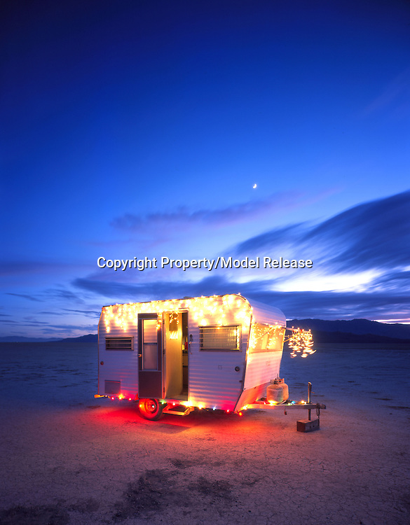 A 1960's era Kit Companion trailer is all decked out for the holidays on Nevada's Black Rock Desert. The photograph was taken by Douglas Keister, who is the author of the recently published book, Silver Palaces: America's Streamlined Trailers, available for $24.95 at bookstores or at www.gibbs-smith.com.