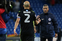Captain Bruno Saltor Grau of Brighton and Hove Albion shakes Brighton and Hove Albion Manager Chris Hughton's hand after the final whistle of the Sky Bet Championship match between Cardiff City and Brighton and Hove Albion at The Cardiff City Stadium, Wales, UK. Saturday 04 December 2016