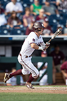 Mississippi State Bulldogs outfielder Jake Mangum (15) follows through on his swing during Game 8 of the NCAA College World Series against the Vanderbilt Commodores on June 19, 2019 at TD Ameritrade Park in Omaha, Nebraska. Vanderbilt defeated Mississippi State 6-3. (Andrew Woolley/Four Seam Images)