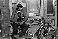 Hot All Nite: Young man with his bicycle on 47th Street, Chicago, Illinois, 1941.<br /> <br /> Photo by Edwin Rosskam.