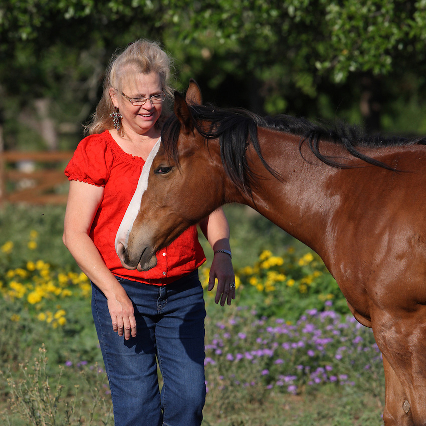 Jolene McCord working with her purebred filly, Dynas Jet.