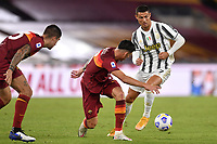 Gianluca Mancini, Roger Ibanez of AS Roma and Cristiano Ronaldo of Juventus FC compete for the ball during the Serie A football match between AS Roma and Juventus FC at Olimpico stadium in Roma (Italy), September 27th, 2020. Photo Antonietta Baldassarre / Insidefoto