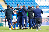 1st May 2021; Weston Homes Stadium, Peterborough, Cambridgeshire, England; English Football League One Football, Peterborough United versus Lincoln City; Peterborough United players and officials celebrate promotion to the EFL Championship after the final whistle