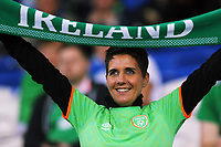 A female Ireland fan holds a scarf during the FIFA World Cup Qualifier Group D match between Wales and Republic of Ireland at The Cardiff City Stadium, Wales, UK. Monday 09 October 2017