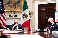United States President Joe Biden, flanked by US Secretary of Homeland Security Alejandro Mayorkas, right, listens during a virtual bilateral meeting with President Andrés Manuel López Obrador of Mexico in the Roosevelt Room of the White House in Washington on March 1st, 2021. <br /> Credit: Anna Moneymaker / Pool via CNP /MediaPunch