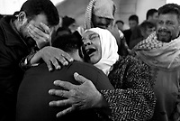 Baghdad, Iraq, March 28, 2003.Najah Sabah, center, is the father of 3 of the 52 victims of the unidentified missile that exploded at dusk in the middle of a crowded market in Al Shuala', a very poor area of North West Baghdad.