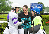 Allison Fulmer laughs it up with European riders  Jimmy McCarthy, left, and Mattie Batchelor, who had a successful day at the Queens Cup races.