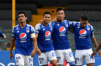 BOGOTA - COLOMBIA, 18-04-2021: Fernando Uribe de Millonarios F. C. celebra con sus compañeros de equipo despues de anotar el primer gol a Deportivo Cali durante partido entre Millonarios F. C. y Deportivo Cali de la fecha 19 por la Liga BetPlay DIMAYOR I 2021 jugado en el estadio Nemesio Camacho El Campin de la ciudad de Bogota. / Fernando Uribe of Millonarios F. C. celebrates with his teammates after scoringthe first goal to Deportivo Cali during a match between Millonarios F. C. and Deportivo Cali of the 19th date for the BetPlay DIMAYOR I 2021 League played at the Nemesio Camacho El Campin Stadium in Bogota city. / Photo: VizzorImage / Luis Ramirez / Staff.