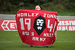 © Joel Goodman - 07973 332324 . 25/04/2015 . Salford , UK . A boy throws his head back as he carries a banner on to the pitch , after the match . Evostick League champions , Salford FC , play Osset Town , in Salford . Photo credit : Joel Goodman