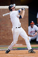 John Hicks #8 of the Virginia Cavaliers follows through on his swing against the VCU Rams at the Charlottesville Regional of the 2010 College World Series at Davenport Field on June 4, 2010, in Charlottesville, Virginia.  The Cavaliers defeated the Rams 14-5.  Photo by Brian Westerholt / Four Seam Images