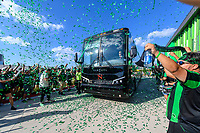 AUSTIN, TX - JUNE 19: Austin FC players arrive as the Supporters Group cheer them on before a game between San Jose Earthquakes and Austin FC at Q2 Stadium on June 19, 2021 in Austin, Texas.