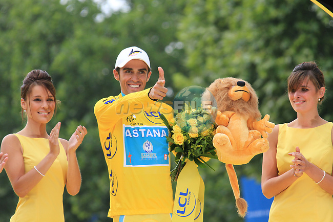 Alberto Contador (ESP) Astana on the podium after winning his 3rd Tour de France at the end of the final Stage 20 of the 2010 Tour de France running 102.5km from Longjumeau to Paris Champs-Elysees, France. 25th July 2010.<br /> (Photo by Eoin Clarke/NEWSFILE).<br /> All photos usage must carry mandatory copyright credit (© NEWSFILE | Eoin Clarke)
