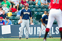 Bryce Harper #34 of the Harrisburg Senators keeps his eye on pitcher John Fitzgerald #31 of the Richmond Flying Squirrels as he takes his lead off third base in game one of a double-header at The Diamond on July 22, 2011 in Richmond, Virginia.  The Squirrels defeated the Senators 3-1.   (Brian Westerholt / Four Seam Images)