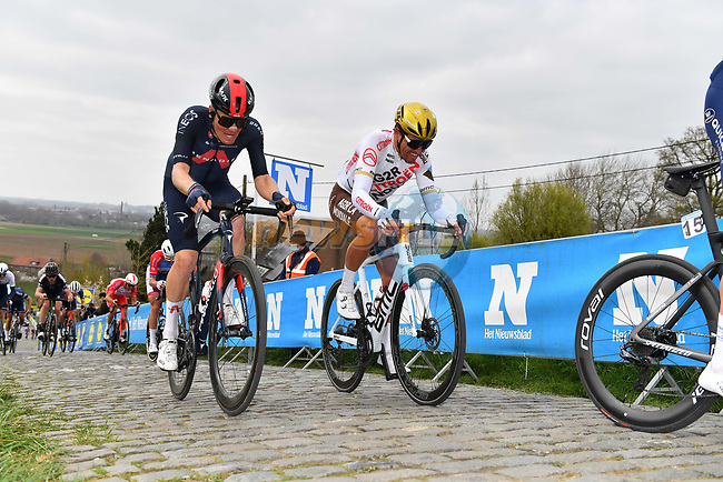 Tom Pidcock (ENG) Ineos Grenadiers and Olympic Champion Greg Van Avermaet (BEL) AG2R Citroen Team climb the Paterberg during the 2021 Tour of Flanders running 254.3km from Antwerp to Oudenaarde, Belgium. 4th April 221.  <br /> Picture: Serge Waldbillig | Cyclefile<br /> <br /> All photos usage must carry mandatory copyright credit (© Cyclefile | Serge Waldbillig)