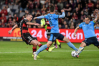 1st May 2021; Bankwest Stadium, Parramatta, New South Wales, Australia; A League Football, Western Sydney Wanderers versus Sydney FC; Mitch Duke of Western Sydney Wanderers shoots past the advancing Joel King and Alex Wilkinson of Sydney to score and make it 2-0 in the 16th minute