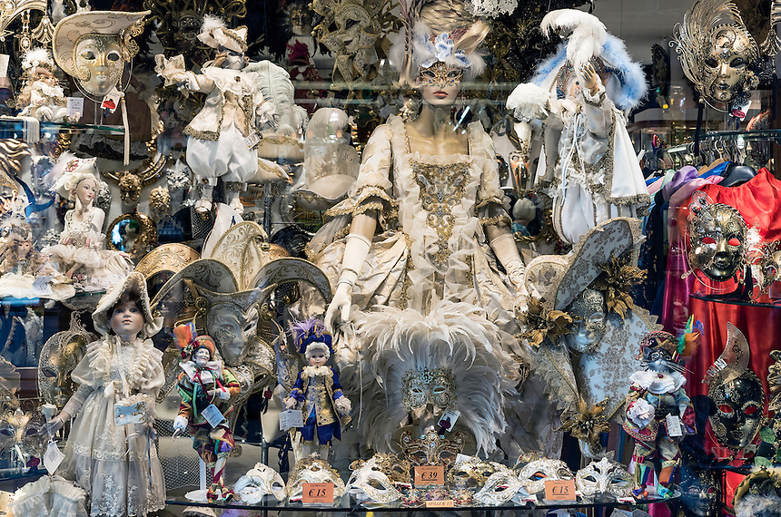 Carnival related items in a shop window, Venice, Italy