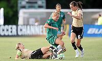Leslie Osborne (on ground) tackles Amanda Cinall, Brandi Chastain #6..Saint Louis Athletica tied 1-1 with F.C Gold Pride, at Anheuser-Busch Soccer Park, Fenton, Missouri.