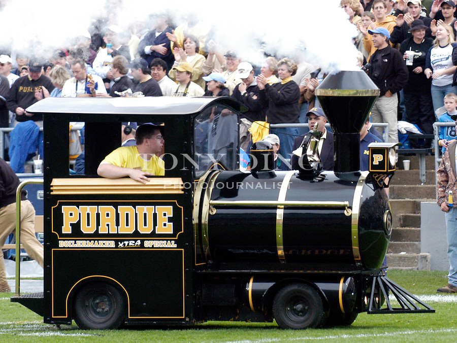 """The Purdue """"Boilermaker XTRA Special"""" miniature steam locomotive during the Wolverines' 16-14 victory over the Purdue Boilermakers on Saturday, October 23, 2004 in at Ross-Ade Stadium in West Lafayette, Ind. (TONY DING/Daily)."""