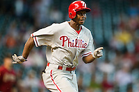 Philadelphia Phillies outfielder Juan Pierre #10 runs to first base during the Major League baseball game against the Houston Astros on September 16th, 2012 at Minute Maid Park in Houston, Texas. The Astros defeated the Phillies 7-6. (Andrew Woolley/Four Seam Images)..