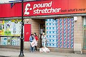 Shoppers outside Poundstretcher, Kentish Town Road, Camden, London.