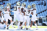 CHAPEL HILL, NC - NOVEMBER 14: Kenneth Walker III #9  of Wake Forest celebrates his touchdown with his teammates during a game between Wake Forest and North Carolina at Kenan Memorial Stadium on November 14, 2020 in Chapel Hill, North Carolina.