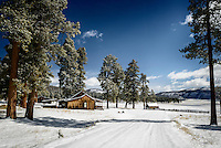 The bunkhouse and corral at the Valles Caldera National Preserve under a fresh layer of spring snow.