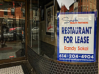 Restaurant for lease sign in front window of 8 State Bistro in Uptown Westerville, Ohio.