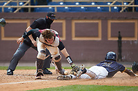 North Carolina Central Eagles catcher Chet Sikes (7) looses control of the ball as Cameran Brantley (32) of the North Carolina A&T Aggies slides into home plate at Durham Athletic Park on April 10, 2021 in Durham, North Carolina. (Brian Westerholt/Four Seam Images)