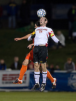 Ara Amirkhanian (21) of Clemson goes up for a header with Patrick Mullins (15) of Maryland during the game at the Maryland SoccerPlex in Germantown, MD. Maryland defeated Clemson, 1-0, in overtime.  With the win the Terrapins advanced to the finals of the ACC men's soccer tournament.