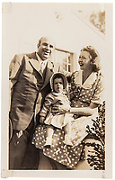 BNPS.co.uk (01202 558833)<br /> Pic: SheldonCarpenter/Witherell'sInc/BNPS<br /> <br /> Pictured: A vintage gelatine silver print of Al Capone with Casey and grandchild Ronnie.<br /> <br /> An incredible treasure trove of Al Capone heirlooms have sold at auction for a whopping £2.3m. ($3.1m)<br /> <br /> The star lot was the notorious American gangster's favourite gun - a 1911 Colt semi-automatic pistol, which was expected to fetch £110,000 but sold for an incredible £764,000. ($1.04m)<br /> <br /> The remarkable collection, sold by his granddaughters, included personalised jewellery, photographs and furniture and a letter written to his only child Sonny from Alcatraz Prison, which showed a tender side to the ruthless crime boss.