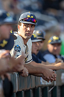 Michigan Wolverines pitcher Jack Bredeson (34) in the dugout before playing against the Vanderbilt Commodores during Game 1 of the NCAA College World Series Finals on June 24, 2019 at TD Ameritrade Park in Omaha, Nebraska. Michigan defeated Vanderbilt 7-4. (Andrew Woolley/Four Seam Images)