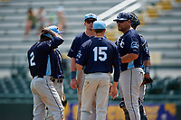 Charlotte Stone Crabs manager Jeff Smith (41) makes a pitching change as (Clockwise) Zach Rutherford (15), Vidal Brujan (2), Tyler Frank (hidden), Russ Olive (center), and catcher Ronaldo Hernandez (24) look on during a Florida State League game against the Bradenton Marauders on April 10, 2019 at LECOM Park in Bradenton, Florida.  Bradenton defeated Charlotte 2-1.  (Mike Janes/Four Seam Images)
