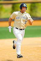 Mac Williamson #7 of the Wake Forest Demon Deacons hustles towards third base against the Georgia Tech Yellow Jackets at Wake Forest Baseball Park on April 15, 2012 in Winston-Salem, North Carolina.  The Demon Deacons defeated the Yellow Jackets 11-3.  (Brian Westerholt/Four Seam Images)