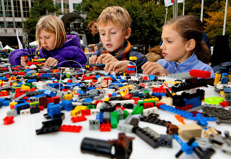 Children build Lego creations during the Wells Fargo Community Celebration, held October 29, 2011 in downtown Charlotte NC. The daylong festival took place in the streets, in public atriums and in downtown museums, which offered free admission all day long. Wells Fargo, which this month completed its conversion from Wachovia, picked up the bill.