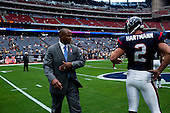 Houston, Texas<br /> October 2, 2011<br /> <br /> Crossing the center of the stadium's field and slapping the behind of Brett Hartmann before the game, general manager and first as executive vice president, Rick Smith oversees all aspects of football operations. Smith has strengthened Houston's roster through the draft, free agency and several trades at key positions.<br /> <br /> The Houston Texans defeated the Pittsburgh Steelers at the Reliant Stadium 17 to 10.
