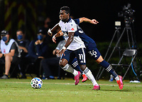 LAKE BUENA VISTA, FL - JULY 26: Cristian Dájome of Vancouver Whitecaps FC turns away from pressure during a game between Vancouver Whitecaps and Sporting Kansas City at ESPN Wide World of Sports on July 26, 2020 in Lake Buena Vista, Florida.