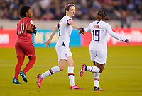 HOUSTON, TX - JANUARY 31: Megan Rapinoe #15 and Crystal Dunn #19 of the United States celebrate a goal during a game between Panama and USWNT at BBVA Stadium on January 31, 2020 in Houston, Texas.