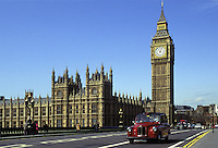 London Cab crossing bridge. Parliament and London Cab.