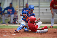 GCL Mets catcher Luis Lebron (16) tags Moises Castillo (4) at the plate during a game against the GCL Cardinals on July 23, 2017 at Roger Dean Stadium Complex in Jupiter, Florida.  GCL Cardinals defeated the GCL Mets 5-3.  (Mike Janes/Four Seam Images)