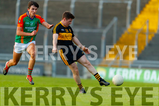 Kieran O'Leary, Dr. Crokes in action against Jack Brosnan, Mid Kerry during the Kerry County Senior Football Championship Semi-Final match between Mid Kerry and Dr Crokes at Austin Stack Park in Tralee, Kerry.